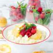 Milk porridge with raspberries and apricots — Stock Photo