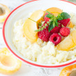 Milk porridge with raspberries and apricots — Stock Photo #28337143