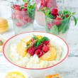 Stock Photo: Milk porridge with raspberries and apricots
