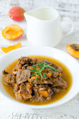 Meat stew with apricots — Stock Photo