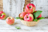 Red apples in a basket — Stock Photo
