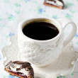 A Cup of coffee with chocolate candy — Stock Photo