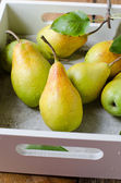 Fresh pears on a wooden table — Stock Photo