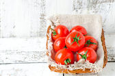 Fresh tomatoes in a basket — Stock Photo
