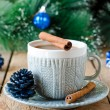 A cup of coffee on a wooden table with Christmas decorations — Stock Photo #35282751