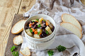 Bean stew with vegetables and meat — Stock Photo