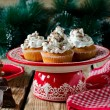 Christmas cupcakes with whipped cream and chocolate — Stock Photo