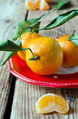 Fresh tangerine on a wooden table — Stock Photo