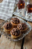 Cupcakes with chocolate cream — Stock Photo