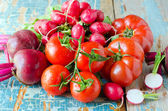 Fresh vegetables on the wooden background — Stock Photo