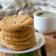 Cookies on a wooden table with a cup of coffee — Stock Photo