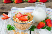 Corn flakes with strawberries , Breakfast . — Stock Photo