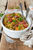 Cabbage stew with lentils and sausages — Stock Photo
