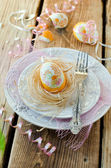 Painted easter egg on a plate — Stock Photo