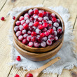 Stock Photo: Cranberries in wooden bowl on wooden table