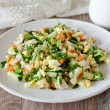 Stock Photo: Salad with chicken, carrots, eggs and cucumbers