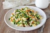 Salad with chicken, carrots, eggs and cucumbers — Stock Photo