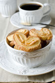 Cookies of puff pastry and a cup of coffee — Stock Photo