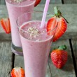 Strawberry smoothie on a wooden table — Stock Photo #42351151