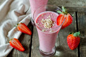 Strawberry smoothie on a wooden table — Stock Photo