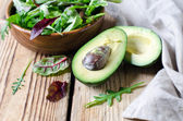 Avocado and salad mix — Stock Photo