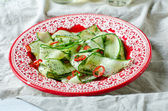 Salad with cucumber, pepper and poppy seeds — Stock Photo