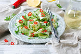 Salad with cucumbers and peppers — Stock Photo