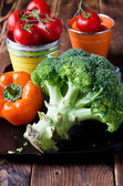 Raw broccoli, tomatoes, peppers — Stock Photo