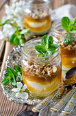 Curd dessert with jam in a glass jar — Stock Photo