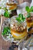 Curd dessert with jam in a glass jar — Stockfoto