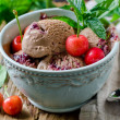 Chocolate ice cream with cherries and mint — Photo