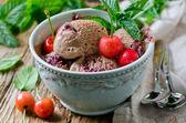 Chocolate ice cream with cherries and mint — Stock Photo