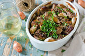 Meat baked with garlic and onion — Stock Photo