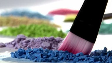 Paintbrush mixing paint. — Stock Video