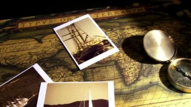 Golden compass and old maps — Stock Video