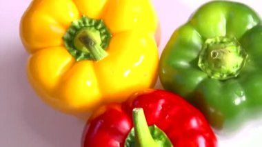 Vegetables, three-color peppers, rotate — Stock Video