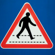 Stock Photo: Warning sign for motorist for Pedestricrossing on blue and white background