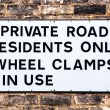 Warning sign for motorists for a Private Road, wheel clamps in use — Stock Photo
