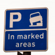 Stock Photo: Curb Parking sign in side street in Cambridge UK
