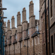 Stock Photo: Chimneys in side street in Cambridge England UK