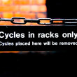 Warning sign for students in a college for cycles in racks only — Stock Photo