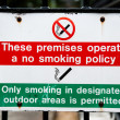 No smoking on premises sign, only smoke in designated areas — Stock Photo #12736683