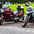 Stock Photo: Parked Motorcycles infront of a city park