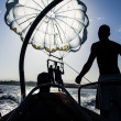 Silhouette of paragliding launching from a boat — Stock Photo