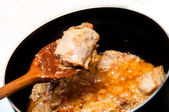 Close up of Chicken curry masal being cooked in a pan — Stock Photo