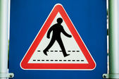 Warning sign for motorist for Pedestrian crossing on a blue and white background — Stock Photo