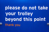 Supermaket sign for customers please do not take trolley beyond — ストック写真
