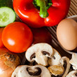 Стоковое фото: Raw egg and vegetables on wooden background