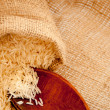 Royalty-Free Stock Photo: Rice spilled on a jute background