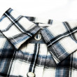 Stylish image of collar of chequered shirt — Stock Photo #23517733